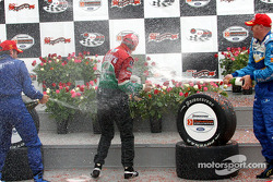 Podium: champagne shower for race winner Adrian Fernandez, Paul Tracy and Alex Tagliani