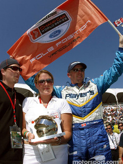 Paul Tracy received the Greg Moore Pole Award from James and Annie Moore, Greg's brother and sister