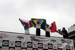 The podium: race winner Bruno Junqueira with Sébastien Bourdais and Alex Tagliani