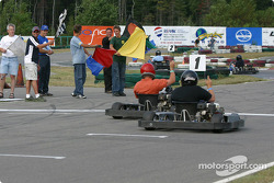 Rocketsports-Tagliani karting event: Alex Tagliani waves the checkered flag for the Rocketsports team race