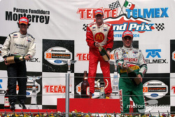 Podium: champagne for Sébastien Bourdais, Bruno Junqueira and Mario Dominguez