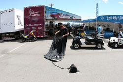 A crew member for Tim Wilkerson folds a chute prior to qualifying runs