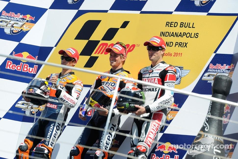 Podium: race winner Casey Stoner, Repsol Honda Team, second place Dani Pedrosa, Repsol Honda Team, third place Ben Spies, Yamaha Factory Racing