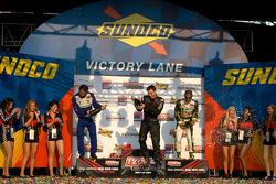 Podium: race winner Will Power, Team Penske, second place Oriol Servia, Newman/Haas Racing, third place Tony Kanaan, KV Racing Technology-Lotus