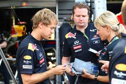 Sebastian Vettel, Red Bull Racing signs a few autographs