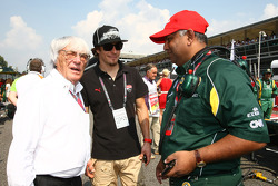 Bernie Ecclestone with Nicky Hayden, MotoGP rider and Tony Fernandes
