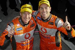 Race winners Craig Lowndes and Mark Skaife celebrate