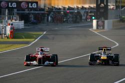 Fernando Alonso, Scuderia Ferrari and Sebastian Vettel, Red Bull Racing