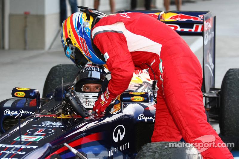 Sebastian Vettel, Red Bull Racing new world champion and Fernando Alonso, Scuderia Ferrari