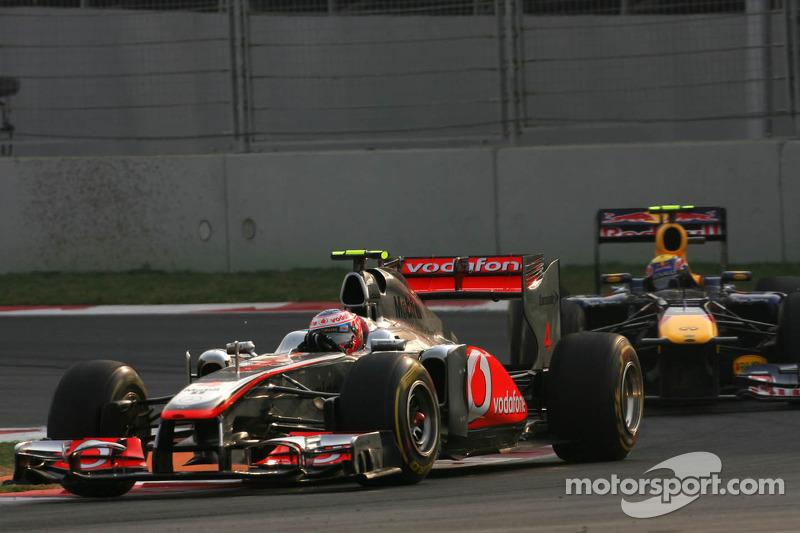 Jenson Button, McLaren Mercedes and Mark Webber, Red Bull Racing