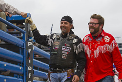 Kyle Petty is helped by Rutledge Wood after riding a bull