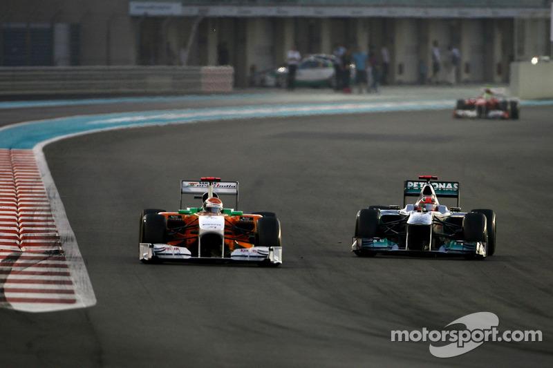 Adrian Sutil, Force India and Michael Schumacher, Mercedes GP