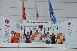 GT500 race 1 podium: winner Ronnie Quintarelli, second place Joao Paulo de Oliveira, third place Juichi Wakisaka