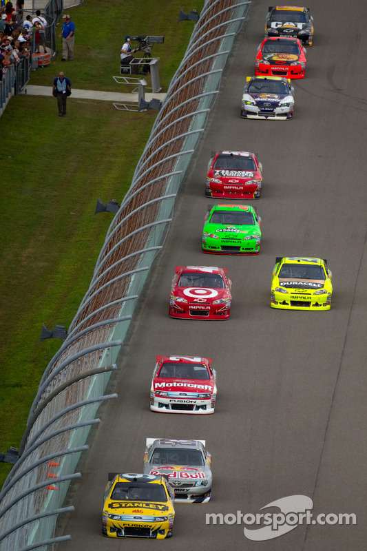Marcos Ambrose, Petty Motorsport Ford leads a goup of cars
