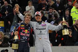 Winners Sebastian Vettel and Michael Schumacher