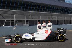 Kamui Kobayashi, Sauber F1 Team with Sergio Perez, Sauber F1 Team and Kamui Kobayashi, Sauber F1 Team