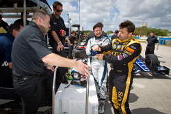Alex Tagliani, Team Barracuda - BHA Lotus and Oriol Servia, Lotus Dreyer & Reinbold Racing Lotus discuss with Bryan Herta
