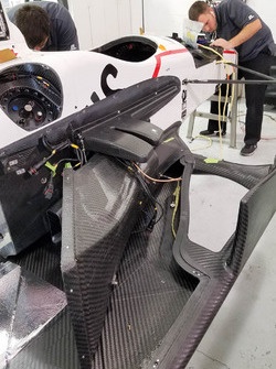 The car of Sébastien Bourdais, Dale Coyne Racing Honda being repaired