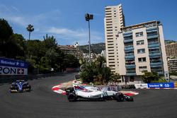 Lance Stroll, Williams FW40, Marcus Ericsson, Sauber C36, on the opening lap
