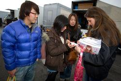 Cyndie Allemann signs autographs for fans