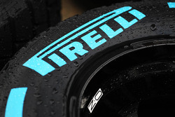 A wet Pirelli tyre coverred in rain drops