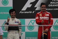 2nd place Sergio Perez, Sauber F1 Team and Fernando Alonso, Scuderia Ferrari