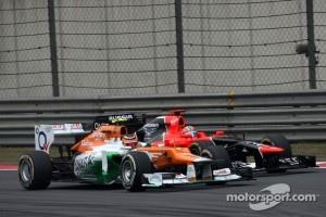 Nico Hulkenberg, Sahara Force India Formula One Team and Timo Glock, Marussia F1 Team