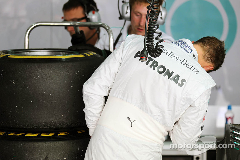 Michael Schumacher, Mercedes AMG F1 takes a look at his worn Pirelli tyres