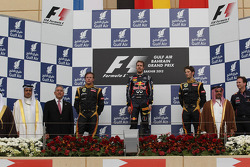 2nd place Kimi Raikkonen, Lotus Renault F1 Team with 1st place Sebastian Vettel, Red Bull Racing and 3rd place Romain Grosjean, Lotus Renault F1 Team