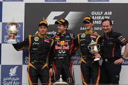 podium and results, 2nd place Kimi Raikkonen, Lotus Renault F1 Team with 1st place Sebastian Vettel, Red Bull Racing and 3rd place Romain Grosjean, Lotus Renault F1 Team with Christian Horner, Red Bull Racing Team Principal