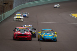 #13 Rum Bum Racing Porsche Carrera: Nick Longhi, Matt Plumb passes #51 Roush Performance Mustang Boss 302R: Shelby Blackstock, Jade Buford