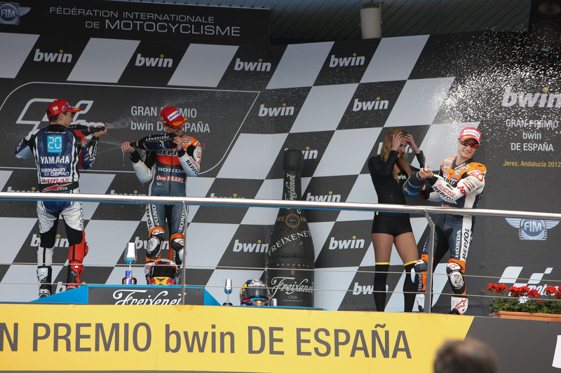 2012 Podio: ganador de la carrera Casey Stoner, del equipo Repsol Honda, segundo lugar Jorge Lorenzo, Yamaha Factory Team, y tercer lugar Dani Pedrosa, Repsol Honda Team
