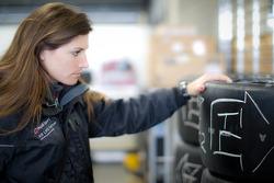 Cyndie Allemann checks tires