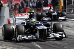Bruno Senna, Williams and team mate Pastor Maldonado, Williams leave the pits