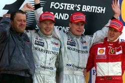 Podium: Race winner David Coulthard, McLaren, second place Mika Hakkinen, McLaren, third place Michael Schumacher, Ferrari and Norbert Haug, Head of Mercedes Sport