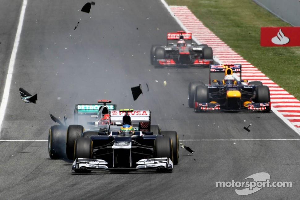 Michael Schumacher, Mercedes GP crashes with Bruno Senna, Williams F1 Team at turn 1