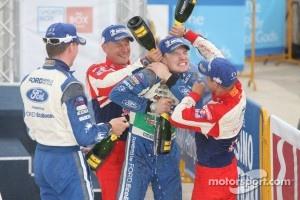 Podium: winners Sébastien Loeb and Daniel Elena, third place Jari-Matti Latvala and Miikka Anttila