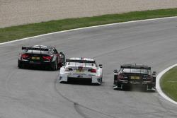 Fight between Edoardo Mortara, Audi Sport Team Rosberg Audi A5 DTM. Martin Tomczyk, BMW Team RMG BMW M3 DTM and Gary Paffett, Team HWA AMG Mercedes, AMG Mercedes C-Coupe