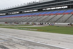 Trucks dry the track during practice