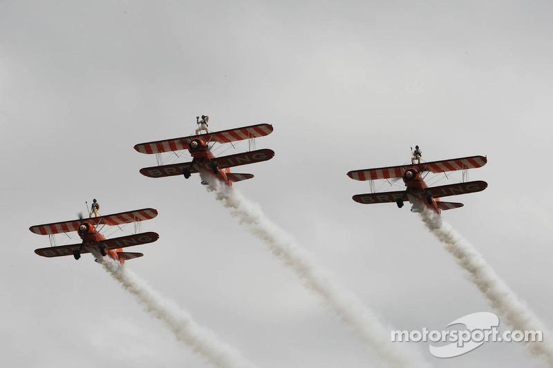 AeroSuperBatics display the Breitling Wingwalkers formation team