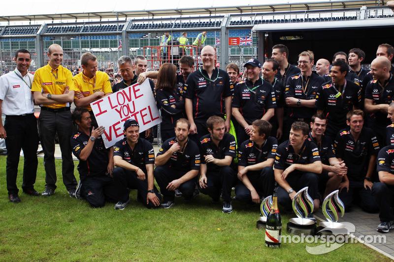 A banner for Sebastian Vettel, Red Bull Racing at the Mark Webber, Red Bull Racing race win celebration