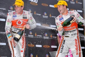 Podium: race winner Jamie Whincup, second place Craig Lowndes at Townsville, and next year their celebrations will include Red Bull signage