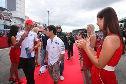 Jenson Button, McLaren Mercedes and Kamui Kobayashi, Sauber F1 Team