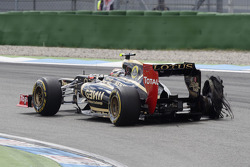 Romain Grosjean, Lotus F1 Team with a exploded tire puncher