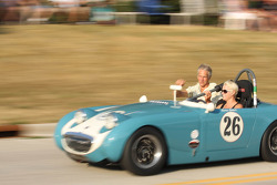 Race Cars parade into Elkhart Lake for the Friday Concours.  #26 1959 Austin Healy Sprite: Cara Comer
