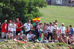 Fans on the grassy banks with a spanish flag