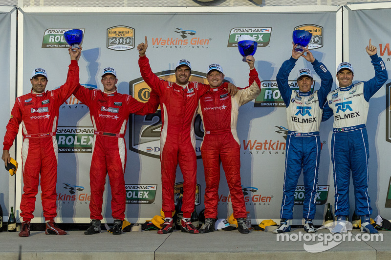 Race winners Lucas Luhr and Ryan Dalziel, second place Alex Popow and Sébastien Bourdais and third p