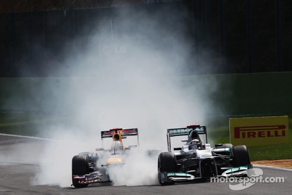 Sebastian Vettel, Red Bull Racing and Michael Schumacher, Mercedes AMG F1 battle for position