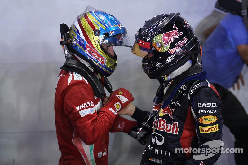 Race winner Sebastian Vettel, Red Bull Racing with third place Fernando Alonso, Scuderia Ferrari