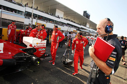 Adrian Newey, Red Bull Racing Chief Technical Officer looks at the Ferrari on the grid